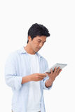 Male looking at his tablet computer Stock Photo