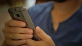 Male looking for information on his mobile phone, scrolling screen with fingers. Stock footage stock video footage