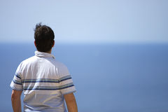 Male Looking Out to Sea Stock Photos