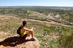 Male looking out towards alice springs. Male looking out from top of cliff into horizon Royalty Free Stock Images