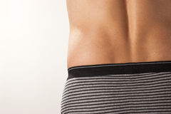 Male Lower Back. The lower back of a man wearing underwear Royalty Free Stock Photo