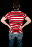 Male with lower back pain on black Stock Photos
