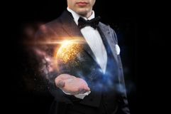 Male magician with planet and space hologram. Magic, imagination and people concept - male magician with planet and space hologram Stock Photography