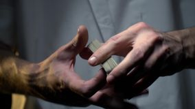 Hands of a male magician in tattoos shuffle playing cards. Male magician`s hands with cards stock video