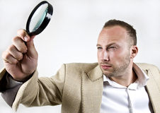 Male with magnifying glass Royalty Free Stock Photos