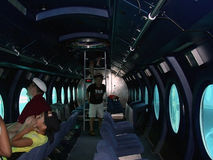 Male, Maldives - August 30, 2003: Strangers - tourists in a subm. Arine in Male, Maldives - August 30, 2003. The interior of a submarine Stock Photos