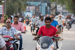 MALE, MALDIVES - FEBRUARY, 13 2016 - Heavy traffic in the street before evening pray time. MALE, MALDIVES - FEBRUARY, 13 2016 - People in the street before Royalty Free Stock Image