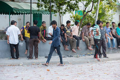 MALE, MALDIVES - FEBRUARY, 13 2016 - People in the street before evening pray time. In male maldives capital small island town Stock Image