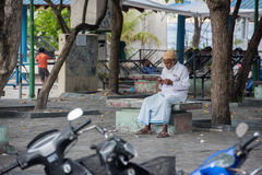 MALE, MALDIVES - FEBRUARY, 13 2016 - People in the street before evening pray time Stock Photos