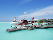 MALE, MALDIVES - JULY 14, 2017: Pilot preparing for a seaplane flight at Male seaplane terminal. He will then take passengers to their choices of island Royalty Free Stock Photos