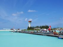 MALE, MALDIVES - JULY 14, 2017: Tourists preparing to get on a seaplane at Male seaplane terminal. Royalty Free Stock Photos