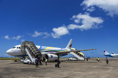 Male Maldives - June 14, 2015 : Passengers are leave a plane Stock Images