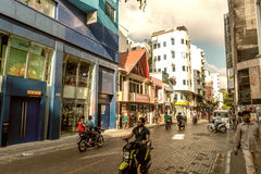 MALE, MALDIVES - MARCH 7, 2015: Locals and tourists along city s Royalty Free Stock Images