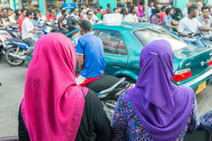 MALE, MALDIVES - MARCH 7, 2015: Locals and tourists along city s Stock Images
