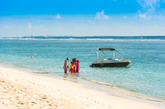 MALE, MALDIVES - NOVEMBER 18, 2016: Boat at the shore of a sandy beach, Maldives islands. Copy space for text. Stock Images