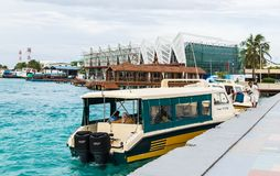 Male, Maldives - November 21, 2017: Tourists coming by speedboats to the international airport of Ibrahim Nasir. Male, Maldives - November 21, 2017: Male Royalty Free Stock Image