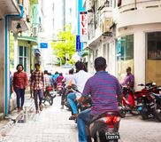 MALE, MALDIVES - NOVEMBER, 27, 2016: View of the city street. People on the city street. Copy space for text. royalty free stock images