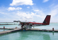 MALE, MALDIVES - SEPTEMBER 07 2008: Twin otter red seaplane Hydroplane at Male airport Royalty Free Stock Images