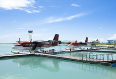 MALE, MALDIVES - SEPTEMBER 07 2008: Twin otter red seaplane Hydroplane at Male airport Stock Images