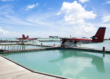 MALE, MALDIVES - SEPTEMBER 07 2008: Twin otter red seaplane Hydroplane at Male airport Royalty Free Stock Image