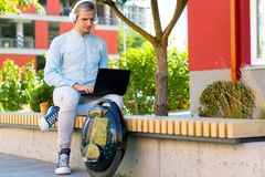 Male man business man student freelancer with electric transport stock images