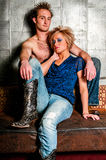 Male / Man and Female / Woman Fashion Model couple. Lovers being romantic Royalty Free Stock Image