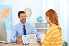 Male manager consulting client stock images