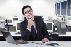 Male manager daydream his idea. Portrait of young businessman imagine his idea while smiling happy at the workplace Stock Image
