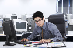 Male manager doing his job in office Stock Images