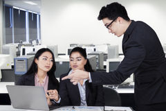 Male manager explain a job with laptop Stock Image