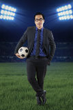 Male manager with football at field Stock Photography