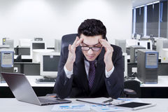 Male manager having headache pain Royalty Free Stock Photo