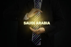 Male manager holding Saudi Arabia word Stock Images