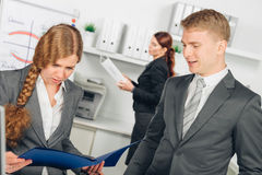 Male manager instructs female employee. Manager instructs employee in office Royalty Free Stock Photography