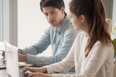 Male manager looking enviously at female rival, competition betw Royalty Free Stock Photos