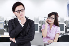 Male manager looking at his subordinate Stock Photography