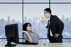 Male manager looks angry with his secretary Stock Images