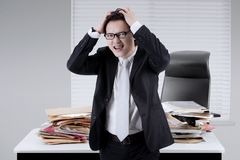 Male manager looks depressed in the office Stock Images
