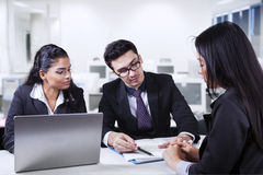 Male manager pointing a document in meeting Royalty Free Stock Photo