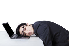 Male manager sleeping on laptop Royalty Free Stock Images