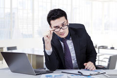 Male manager staring at the camera in office Royalty Free Stock Photo