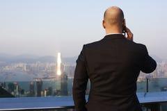 Male managing director phoning via cellphone during work break Stock Image