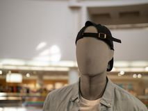 Male mannequin with backwards baseball cap in a department store. A male mannequin with backwards baseball cap in a department store royalty free stock photography