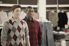 Male mannequins. Smiling and wearing stylish clothing Stock Images