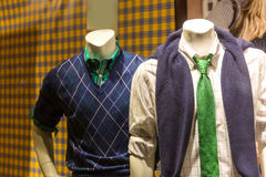 Male mannequins in modern youth clothes. In showcase of shop store Stock Photography