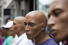 Male mannequins outside store. Stock Image