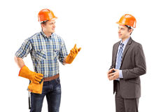 Male manual worker having a conversation with architect Stock Images