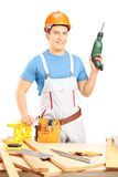 Male manual worker holding a hand drilling machine in a workshop Royalty Free Stock Photo