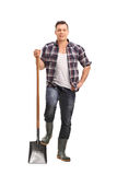 Male manual worker holding a shovel Stock Image