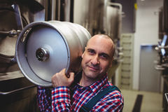 Male manufacturer carrying keg Royalty Free Stock Photo